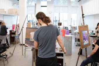 Portland State University art practice students working in an art studio