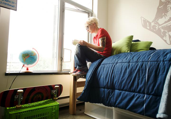 student in dorm room